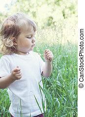 girl in the tall grass
