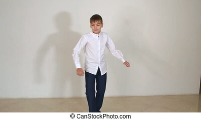 Portrait of a little boy in a white shirt in the Studio on a white background.