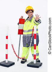 portrait of a little boy in construction clothes
