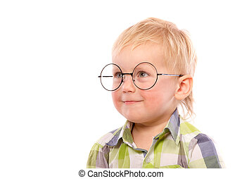 Portrait of a little boy in funny glasses