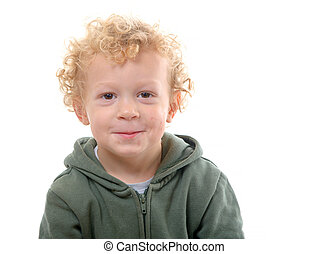portrait of a little boy of 3 years with a green coat