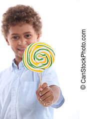 portrait of a little boy with lollipop