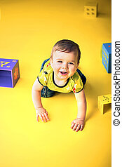 Portrait of a little crawling boy