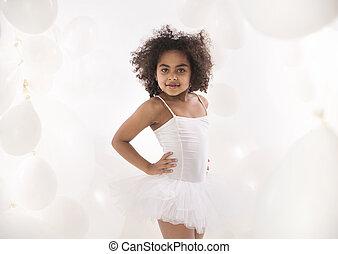 Portrait of a little cute ballet dancer
