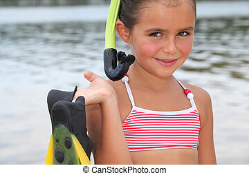 portrait of a little girl at the beach