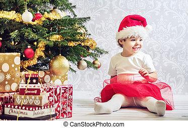 Portrait of a little girl dressed up a santa