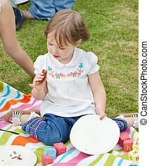 Portrait of a little girl having a picnic