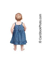 Portrait of a little girl in dress behind