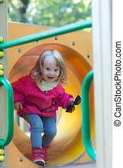 girl in motion on a playground