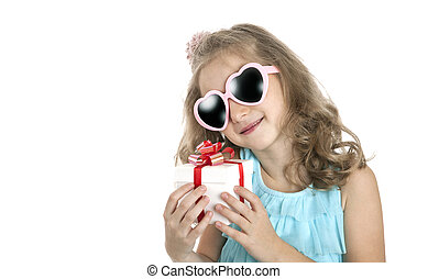 portrait of a little girl in pink sunglasses with gift box