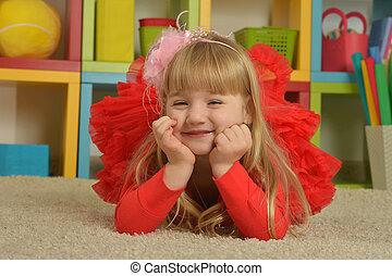 little girl  in red dress at home