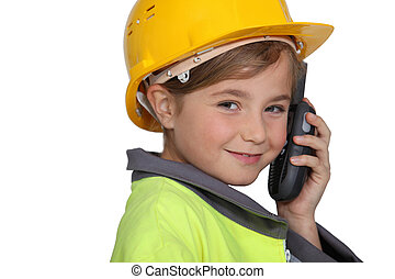 portrait of a little girl in construction clothes
