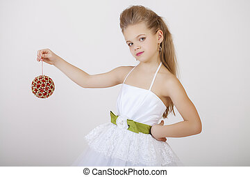 Portrait of a little girl in white classic dress