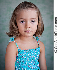 portrait of a little girl on a blue background