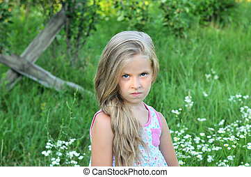 Portrait of a little girl on a green background.