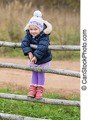 girl on a wooden fence
