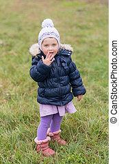 little girl on green grass