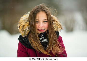Portrait of a little girl outdoor in amazing winter.