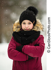 Portrait of a little girl outdoors in an amazing winter.