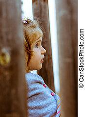 portrait of a little girl outside