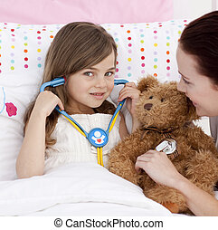 Portrait of a little girl playing with a stethoscope