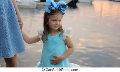 portrait of a little girl three years with the blue bow on her head