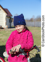 little girl with a bicycle