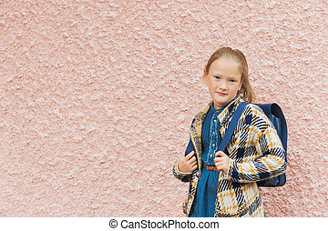 Portrait of a little girl with backpack