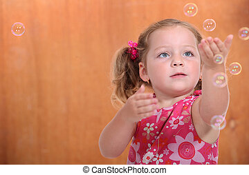 portrait of a little girl with bubbles