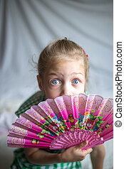 portrait of a little girl with fan