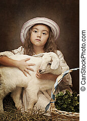 Portrait of a little girl with her pet goat