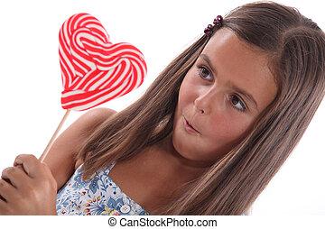 portrait of a little girl with lollipop