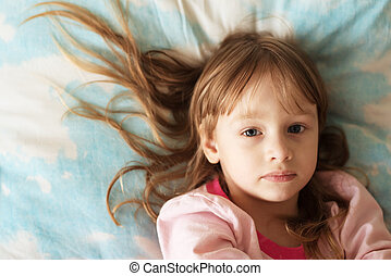 Portrait of a little girl with long hair