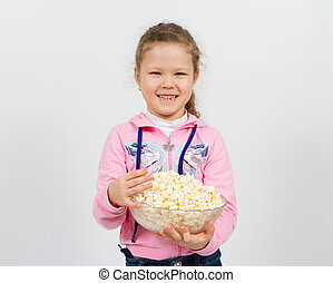Portrait of a little girl with popcorn