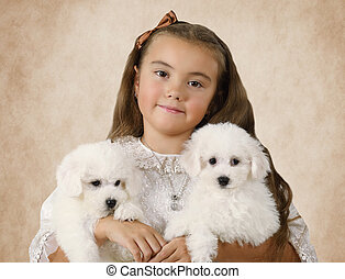Portrait of a little girl with puppies