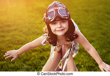 Portrait of a little pilot girl having fun