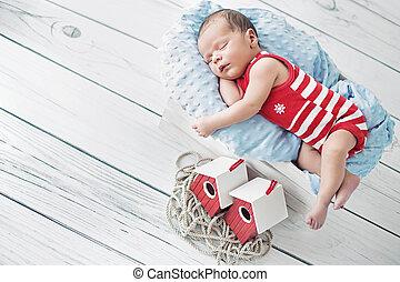 Portrait of a little sailor during the nap