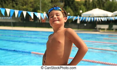 Portrait of a Little Swimmer smiling to camera