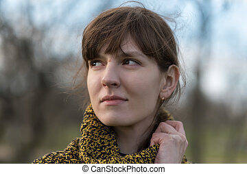 Portrait of a lonely girl in profile.