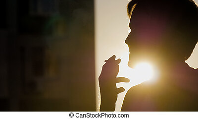 Portrait of a lonely man smoking  cigarette
