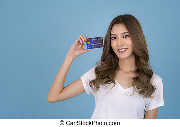 Portrait of a lovely asian young girl in white T Shirt showing credit card