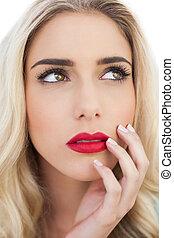 Portrait of a lovely blonde model looking away