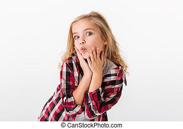 Portrait of a lovely little girl posing