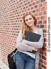 Portrait of a lovely student holding her binder