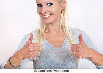 Portrait of a lovely woman with thumbs up
