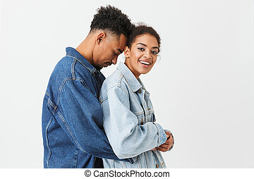 Portrait of a lovely young african couple hugging