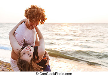 Portrait of a lovely young couple hugging at the beach