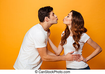Portrait of a lovely young couple kissing