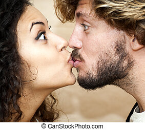 Portrait of a loving couple giving a kiss.