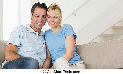 Portrait of a loving couple sitting